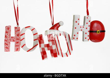 Festive Ho Ho Ho hanging candy Christmas tree ornaments on a white background - Stock Photo