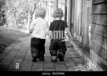 Twins walking away - Stock Photo