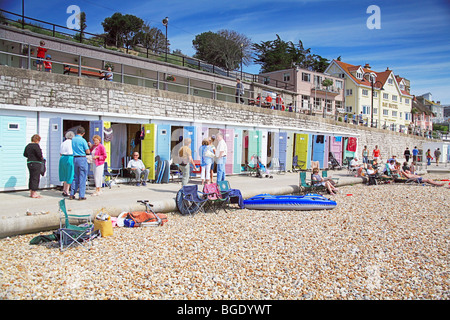 Colourful beach huts on the sea front at Lyme Regis, Dorset, England, UK - Stock Photo