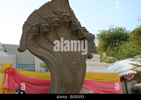 Snake statue at the entrance of a Buddhist temple in Bangkok, Thailand. - Stock Photo
