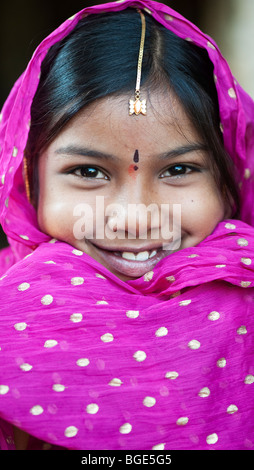 Smiling happy Indian girl wearing a black shawl - Stock Photo