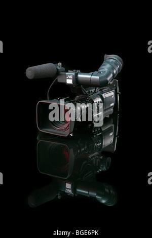 Studio Product Shot of a Prosumer Digital Movie Camera on a black background. - Stock Photo