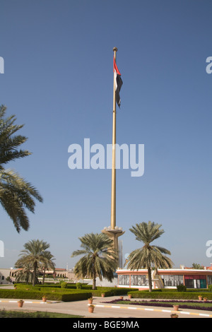 Dubai United Arab Emirates Tall flagpole with the UAE flag flying - Stock Photo