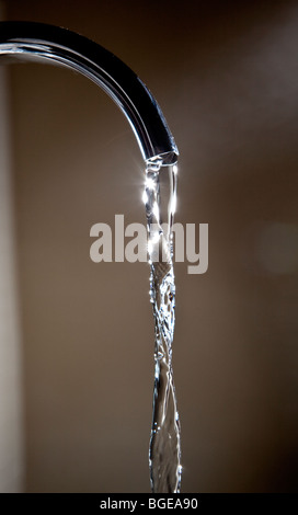 Water running from a domestic tap. - Stock Photo
