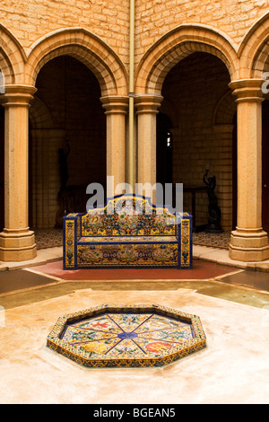 Tiled seating in a courtyard at Bangalore Palace. Bangalore Palace is modeled Windsor Castle in England. - Stock Photo