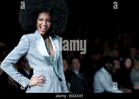 Female model blinked her eyes on the runway at the LG Fashion Week 2009 Wear Love, the biggest annual fashion event - Stock Photo