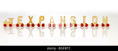 A toy letter carts train forming word expansion - Stock Photo