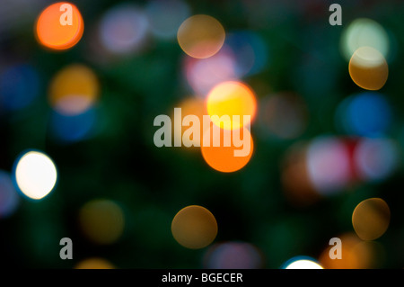 Bokeh created by blurred Christmas tree lights - Stock Photo
