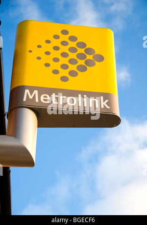 A Metrolink sign outside a tram station in Manchester, England, UK - Stock Photo
