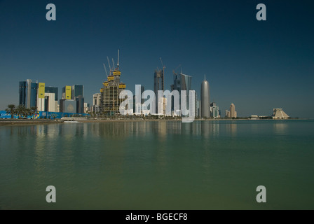 Cityscape view of downtown Doha, Qatar with sea in foreground - Stock Photo