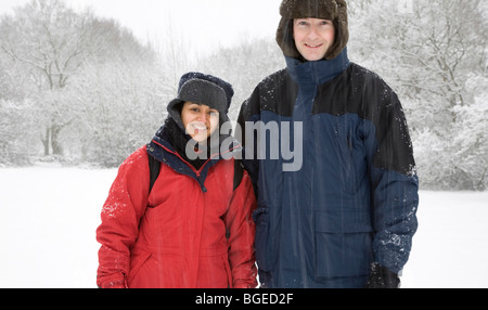Mixed race couple in winter snow scene - Stock Photo
