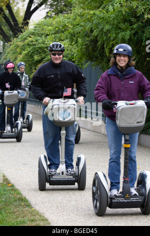 Tourists sightsee around Washington DC on Segway personal transporters - Stock Photo