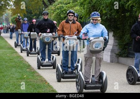 Tourists sightsee around Washington DC on Segway PT personal transporters - Stock Photo