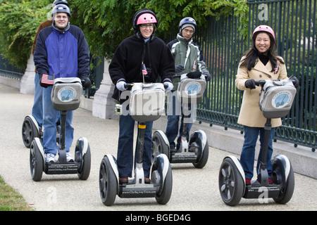 Tourists sightsee around Washington DC on Segways personal transporters - Stock Photo