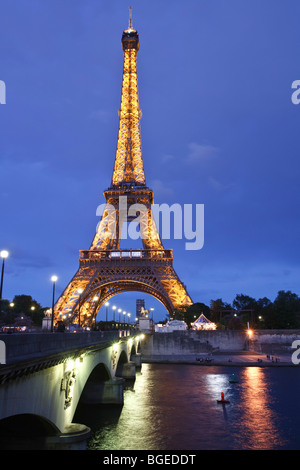 Eiffel tower and Pont d'lena over the Seine at dusk in Paris, France - Stock Photo