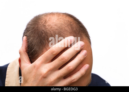 Man expressing stress, worry or depression; isolated against a white background - Stock Photo