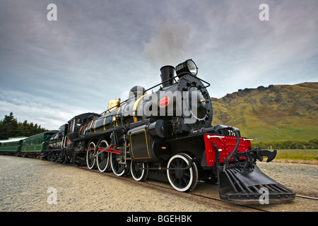 Kingston Flyer, a steam train built in 1925, pulling out of the Fairlight Station in Central Otago, South Island, - Stock Photo