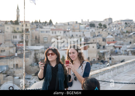 Israel, Jerusalem Old City, Two female tourists admire the View of the old city from the roof of the Austrian Hospice - Stock Photo