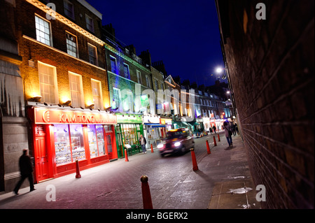 Row of Chinese restaurants in backstreet of Chinatown. Lisle Street. Soho. London. UK 2009 - Stock Photo