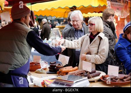 Middle class customers shopping at a Polish sausage stall. Borough Market. London. UK - Stock Photo