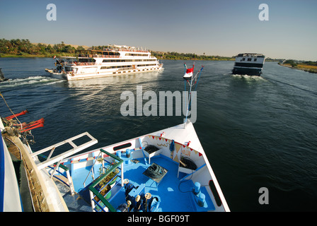 RIVER NILE, UPPER EGYPT. A view of Nile cruise boats sailing upriver towards Aswan. 2009. - Stock Photo