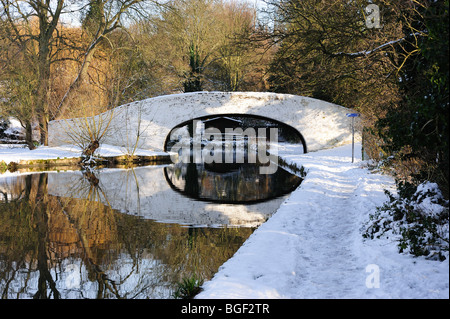 Bridge 163 reflection in the water of the Grand Union Canal near Hunton Bridge on a snowy winter day - Stock Photo