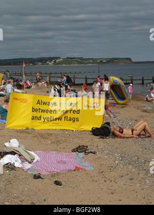 rnli warning sign safe bathing area Dawlish warren beach devon UK - Stock Photo