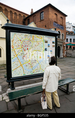 Person looking at an information street map of Krakow outside the Old Synagogue – Stara Synagoga – in Kazimierz, - Stock Photo