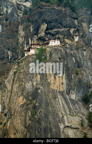 Taksang Monastery (Tiger's Nest) on granite cliffs above Paro, Bhutan - Stock Photo