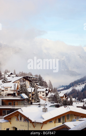 St Anton am Arlberg, Tyrol, Austria, Europe. Chalet rooftops covered with snow in the Alpine ski resort in mid winter - Stock Photo
