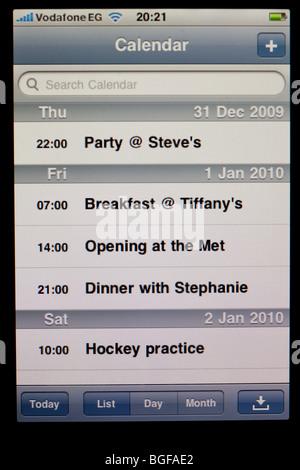 screen of Apple iPhone showing calendar - Stock Photo
