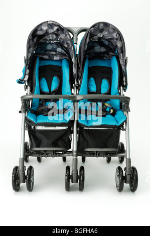 A twin blue double baby stroller carriage - Stock Photo