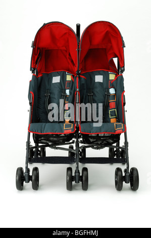 A twin red double baby stroller carriage - Stock Photo