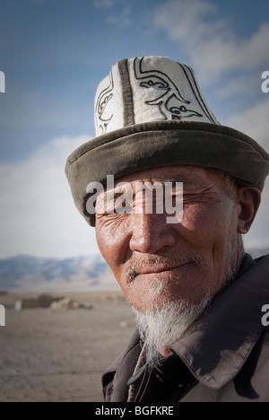 Portrait of a old Kyrgyz Man with traditional hat (Kalpak),  Karakul, Tajikistan - Stock Photo