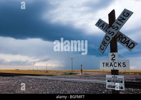 Railroad crossing sign, in rural Nebraska. - Stock Photo