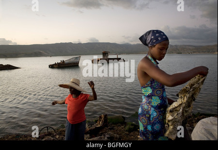Women selling clothes at the port in Gonaives, Artibonite Department, Haiti - Stock Photo