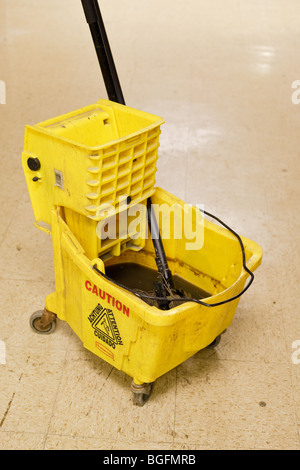 A mop bucket and mop - Stock Photo