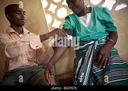 Woman receiving a medical exam, Chekereni Village, Tanzania, East Africa. - Stock Photo