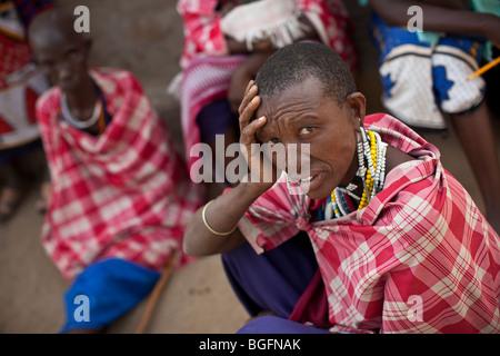 A Maasai woman at a medical dispensary in Tanzania: Manyara Region, Simanjiro District, Kilombero Village. - Stock Photo
