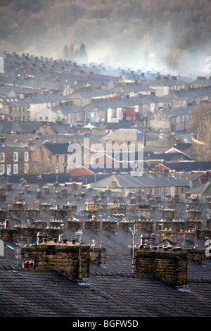 Houses and Chimneys _The industrial rooftops of industrial terraced houses in Accrington, Lancashire - Stock Photo