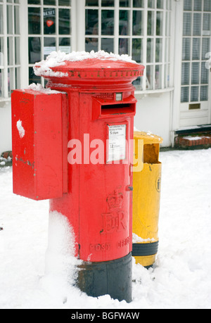 Snow Covered Red Postbox - Stock Photo