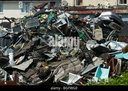A pile of old metal in a scrapyard ready for recycling. - Stock Photo