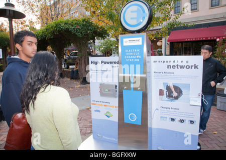 Display about electric vehicle charging stations network infrastructure. Nissan Leaf Zero Emission Tour promotional - Stock Photo