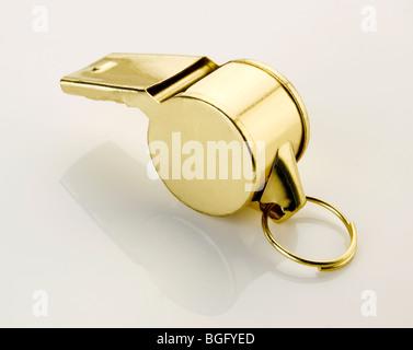 Gold sports whistle - Stock Photo