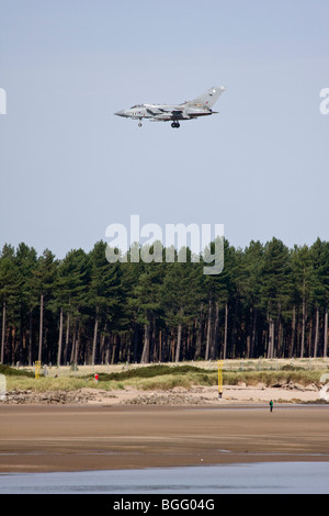 RAF Tornado coming in to land over beach at Leuchars, Fife, Scotland - Stock Photo