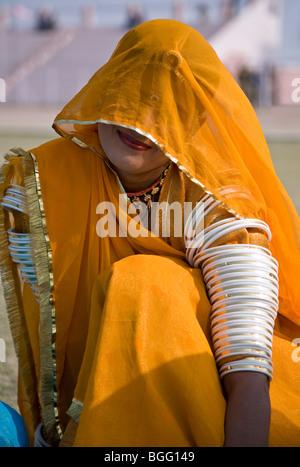 Indian woman wearing traditional sari and bangles. Bikaner. Rajasthan. India - Stock Photo