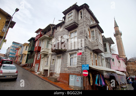 Old wooden architecture houses standing next to The Byzantine Church of St. Savior in Chora,  Edirnekapı, Istanbul, - Stock Photo