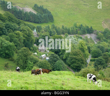 View over the village of Ecton in the Staffordshire Peak District showing spoil heaps from its former copper mines - Stock Photo