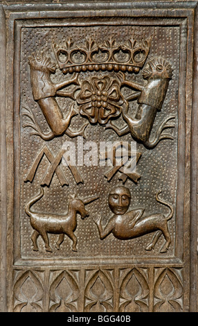 Carved medieval bench end showing the Lutteral coat of arms in the church of St Mary the Virgin at East Quantoxhead - Stock Photo
