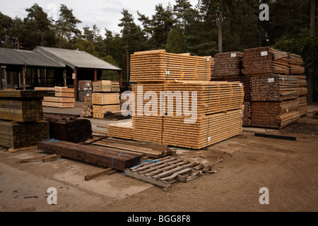Modern treated wooden fencing in stacks at timber Merchants, England - Stock Photo
